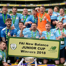 North End United players celebrate with the cup following the FAI New Balance Junior Cup Final match between Pike Rovers and North End United