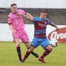Drogheda United goalscorer Chris Lyons holds off Conor Sutton who made a welcome return to the Wexford F.C. colours after a long injury lay-off