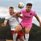 Aaron Dobbs of Wexford F.C. battles with Shelbourne's Derek Prendergast in the air