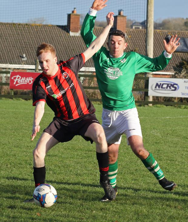 Paul Brennan of Gorey Rangers is tracked by Ricky Fox of Shamrock Rovers