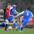 Paul Brennan of Gorey Rangers tries to skip past Freebooters duo Andrew Wall and Peter Higgins