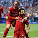 Jordan Henderson celebrates with Mohamed Salah after the striker had fired Liverpool in front from the penalty spot