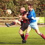 Joe Bolger of Gorey Rangers gets to the ball ahead of Mark McCann and Matthew Murphy of Park Celtic
