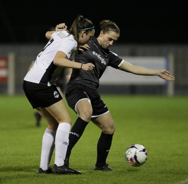 Edel Kennedy of Wexford Youths holding off Galway's Chloe Singleton