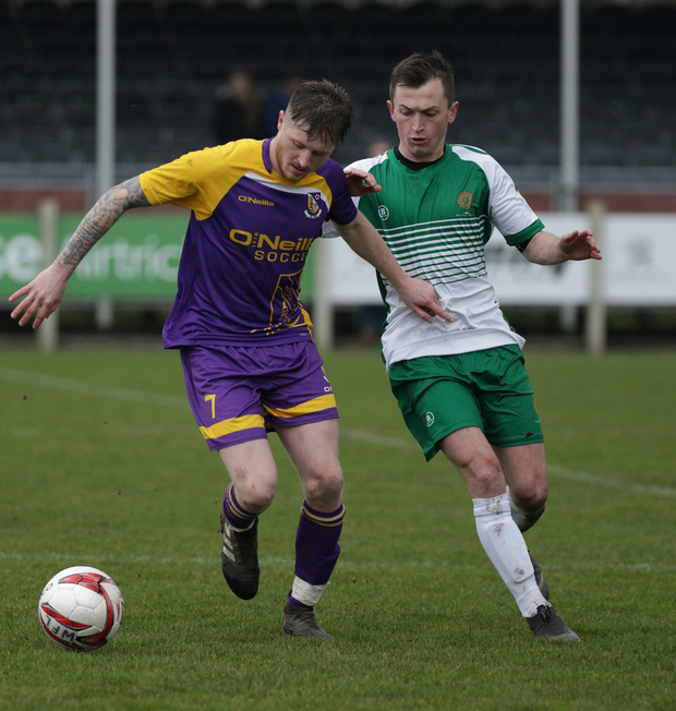 John Peare of Wexford tries to get away from Adrian Rafferty of the Defence Forces