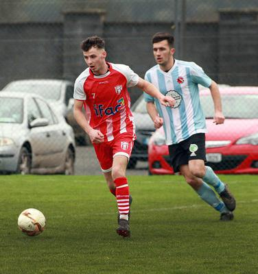 Lenny Connolly of Moyne Rangers breaking away from Ryan Cullen (Gorey Rangers) during Sunday's Premier Division clash in Ramstown