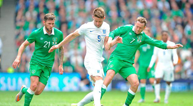 England's Gary Cahill (centre) in action with Republic of Ireland's Daryl Murphy (left) and Aiden McGeady during the international friendly