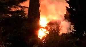 Flames leap more than 10 metres at the height of the blaze in Milltown