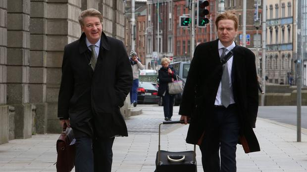 Brian O'Donnell (left) and his son Blake arrive at the High Court in Dublin