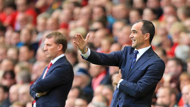 Everton manager Roberto Martinez, right, and Liverpool manager Brendan Rodgers on the touch-line.