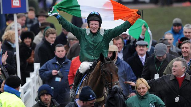 Colman Sweeney celebrates on Salsify after winning the 2013 Foxhunter Chase