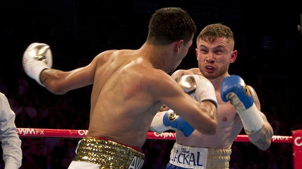 Carl Frampton, right, stopped Chris Avalos in the fifth round of their bout at the Odyssey Arena in Belfast.