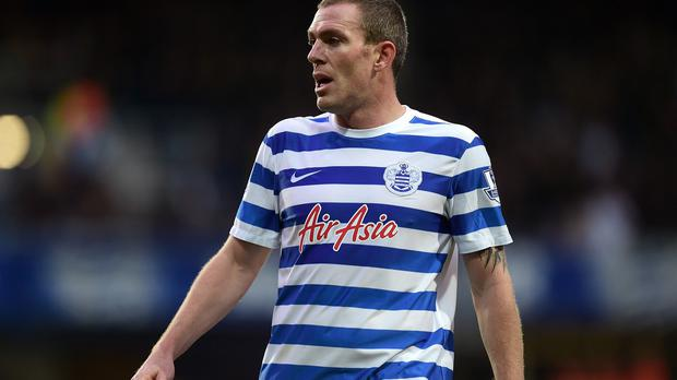 Richard Dunne in action for QPR this season.