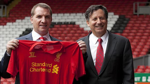 Liverpool manager Brendan Rodgers, left, has been given the go-ahead to plan for next season