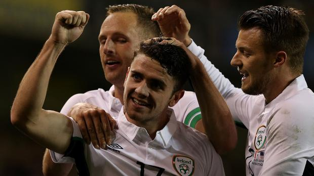 Robbie Brady, centre, is backing Aiden McGeady to shine against Scotland