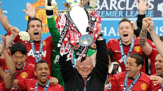 Sir Alex Ferguson, centre, lifting the Premier League in 2013