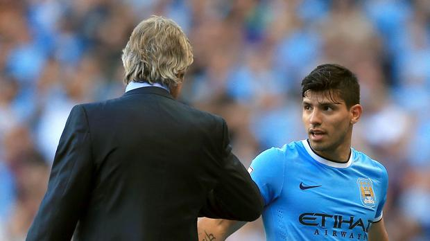 Manchester City manager Manuel Pellegrini, left, believes Sergio Aguero, right, is one of the best players in the world