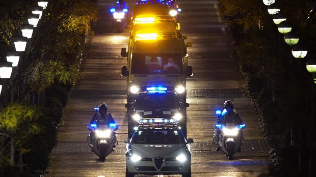 A convoy transporting a Spanish nurse who believed to have contracted Ebola virus from a priest leaves Alcorcon Hospital in Madrid (AP Photo/Andres Kudacki)