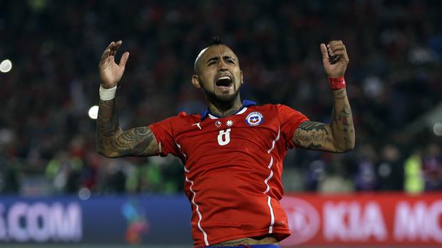 Chile's Arturo Vidal celebrates after scoring during a penalty shootout in the Copa America final in Santiago (AP)