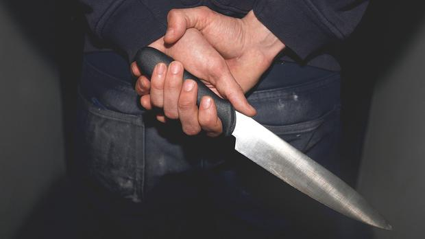The man was attacked with knives and hurleys