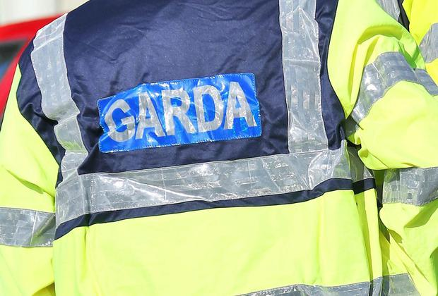 A MAN tore a garda's stab vest in two after calling him a