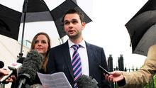 Daniel and Amy McArthur of Ashers Baking Company, outside Belfast County Court where he reads a statement to the media following a ruling that the bakery discriminated against a gay man