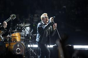 Bono gets the crowd going in Paris