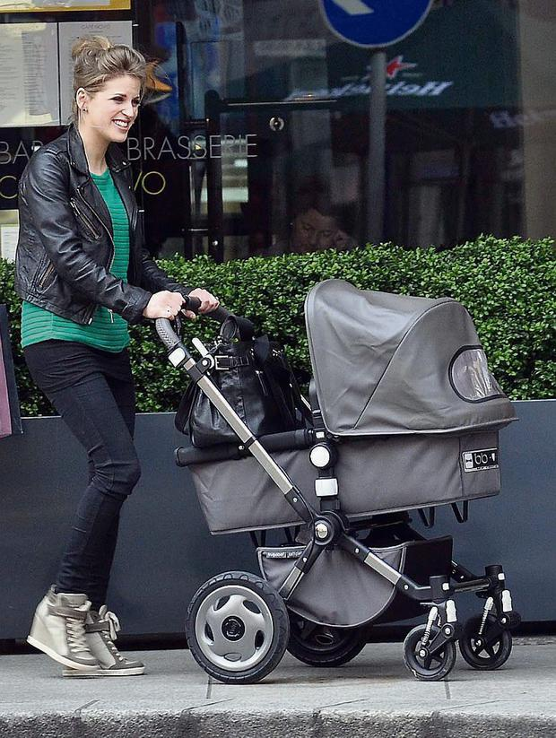DUBLIN / IRELAND 28-04-13 Actress Amy Huberman out and about Grafton st today wheeling her new baby Sadie around in her buggy.Amy was also wearing her own range of shoes which she recently launched. PICTURED-Amy Huberman and baby Sadie PHOTOS ( JOHN DARDIS )