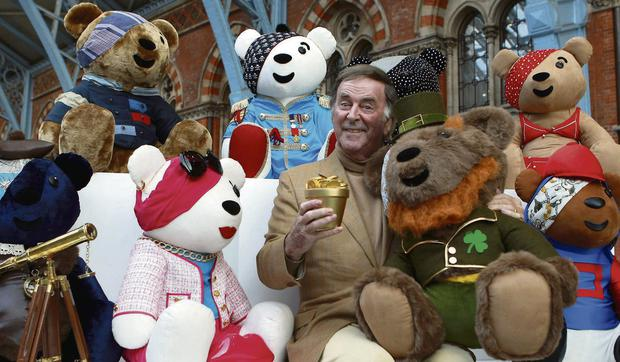 BEAR ESSENTIALS: Terry Wogan shows the collection of Pudsey Bears designed by celebrities at London's St Pancras International Station. The bears are to be auctioned to help Children in Need
