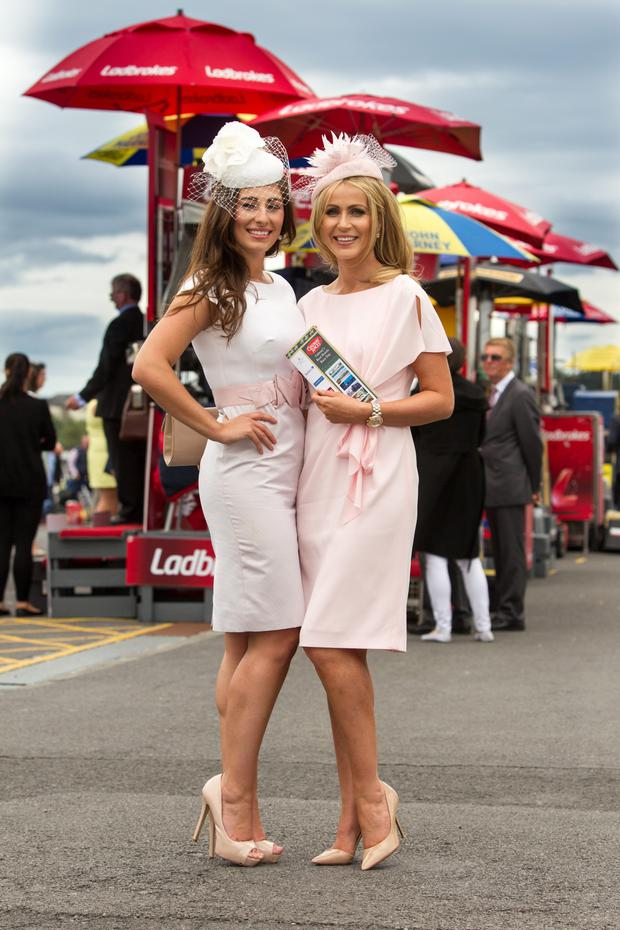 Andrea Guerrero from County Clare and Mary Lee from County Galway enjoying the first day of the Galway racing festival. Photo: Mark Condren