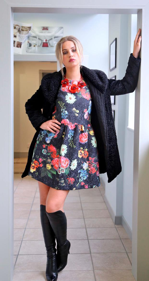 Thalia Heffernan wears black boucle coat by Precis Petite at EUR329 and floral brocade embellished dress by Almost Famous at EUR175 pictured at the launch of the Clerys Autumn Winter Collection at their shop on O'Connell Street, Dublin