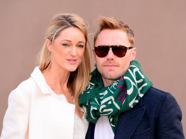 Ronan Keating with girlfriend Storm Uechtritz arriving for the Burberry Prorsum womenswear catwalk show at Kesington Gardens, as part of London Fashion Week