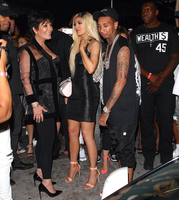 Kylie Jenner with her mum and boyfriend Tyga