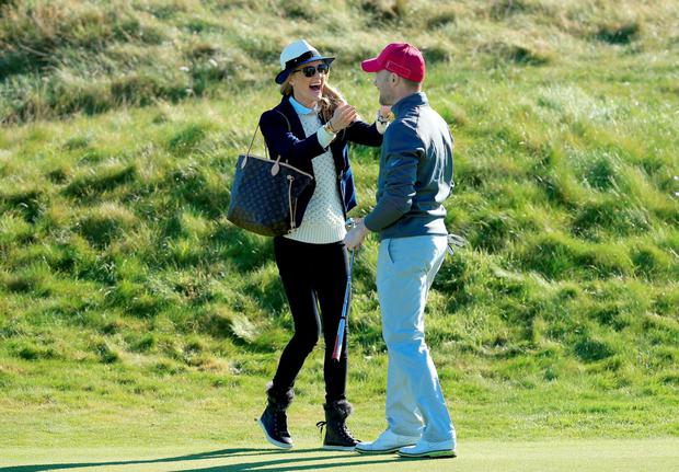 Ronan Keating of Ireland is congratulated by his wife Storm Keating after he had holed a par putt on the second hole during the first round of the 2015 Alfred Dunhill Links Championship at Carnoustie
