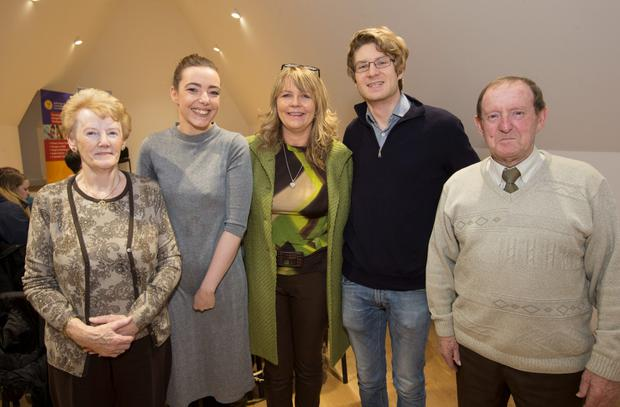 Two of the three George Byrne Bursary recipients, Laura Spencer and Rob Dunlop pictured with George's parents Kay and Michael with his sister Andrea (centre) on December 3, 2015