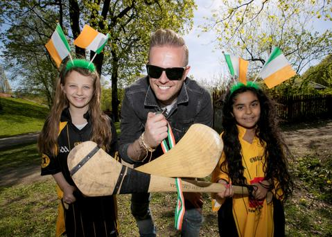 Ireland's Eurovision entry Nicky Byrne is pictured meeting fans near his hotel in Stockholm on the run up to his jury vote rehersal. Nicky is pictured with Freia O'Connor (9) and Aylin Mollazhi (8) whos parents play in the local Stockholm Gaels GAA club.