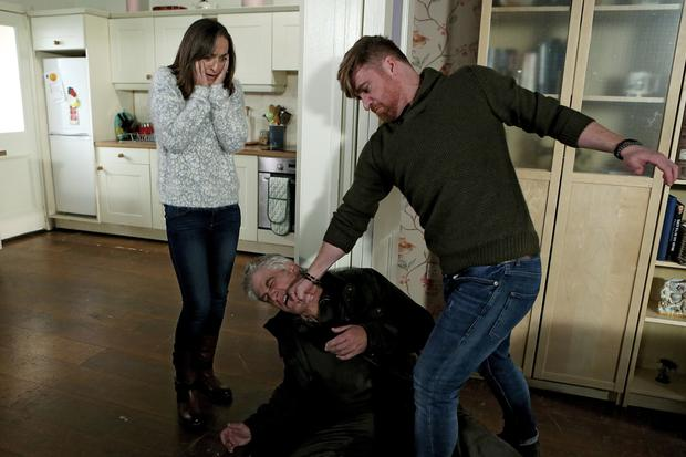 Fair City: Emmet tries to beat the truth out of Tommy. L-R Debbie (Niamh Daly) Tommy (Geoff Minogue) Emmet (Daithy MacSuibhne)
