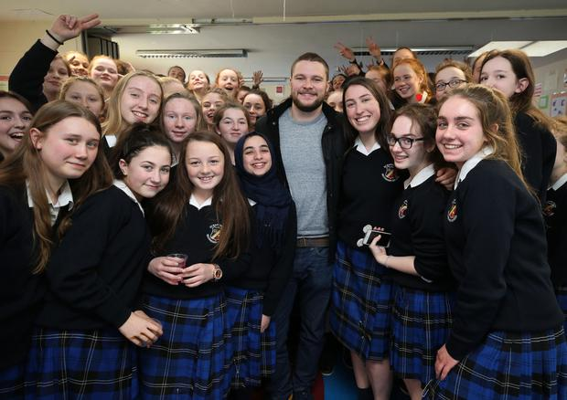 Irish actor Jack Reynor with pupils from St Rapaelas secondary school in Stillorgan, the students put on a fashion show as part of a Build-a-Bank event