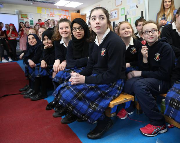 Pupils at St Rapaelas secondary school in Stillorgan, where Irish actor Jack Reynor was visiting to watch a fashion show as part of a Build-a-Bank event