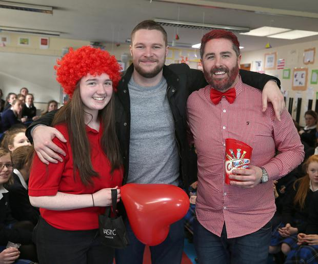 Jack Reynor with teacher, Stephen Fallon and pupil, Kate Farrell at St Rapaelas secondary school in Stillorgan, he was there to watch a fashion show as part of a Build-a-Bank event.