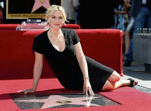 STAR POWER: Actress Kate Winslet poses with her star  on the Walk  of Fame in  LA and
