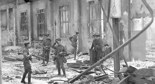 British soldiers inspect the interior of the shelled GPO. Photo: Getty