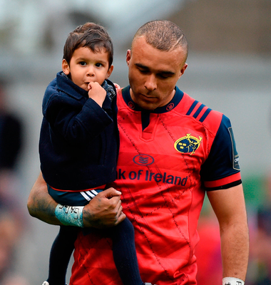Munster's Simon Zebo, with his son Jacob, after the game. Photo: Sportsfile