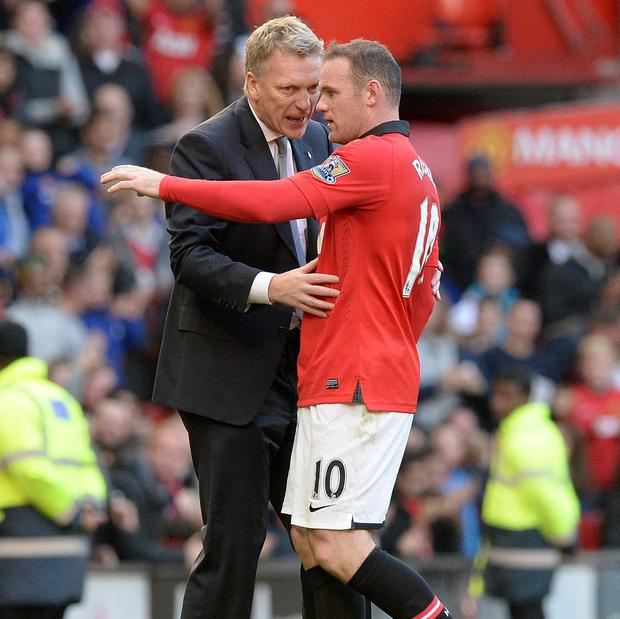 Manchester United manager David Moyes and Wayne Rooney. Picture: Martin Rickett/PA Wire