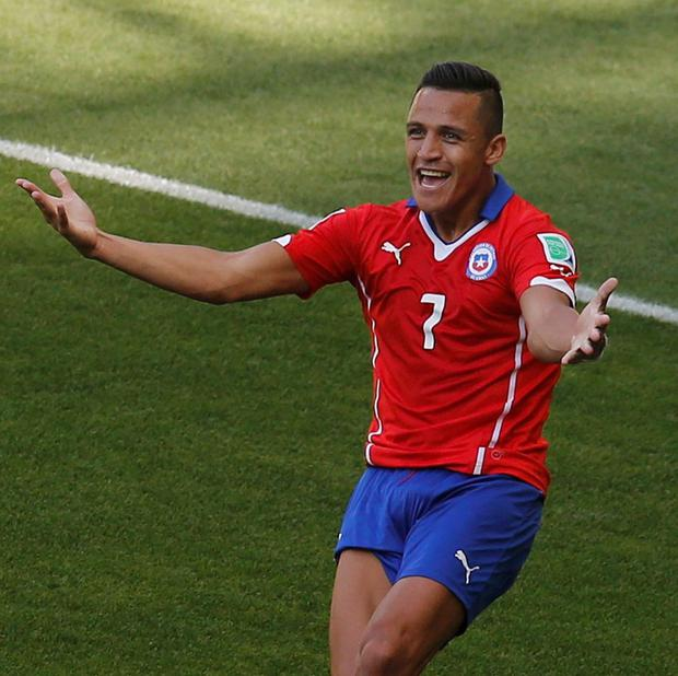 Chile's Alexis Sanchez celebrates after scoring a goal against Brazil during their 2014 World Cup round of 16 game at the Mineirao stadium in Belo Horizonte June 28, 2014. Picture: Reuters/Leonhard Foeger.