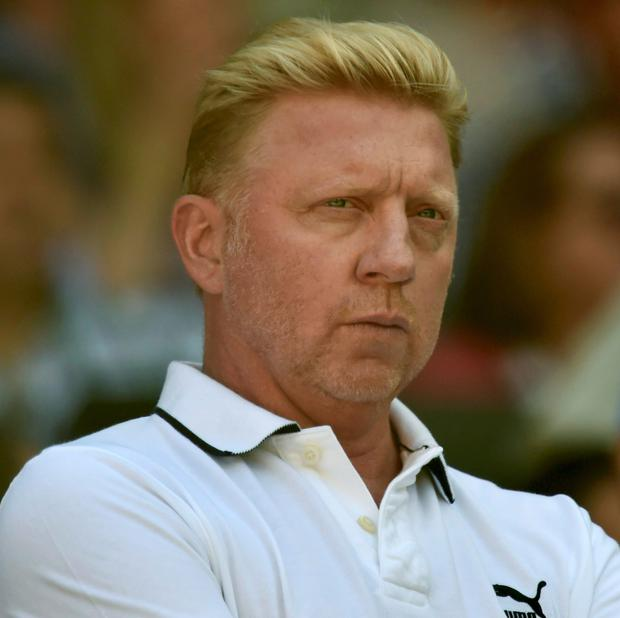 Boris Becker, the coach of Novak Djokovic of Serbia, sits on Centre Court for the men's singles semi-final tennis match between Djokovic and Grigor Dimitrov of Bulgaria at the Wimbledon Tennis Championships, in London July 4, 2014. Picture: Reuters/Toby Melville.