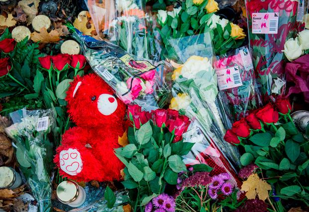 Flowers have been set outside a primary and middle school in Trollhattan, southwestern Sweden, on October 23, 2015, where a masked man armed with a sword yesterday killed two people before being arrested and shot by police. The killer, identified in the media as Anton Lundin-Pettersson, went from classroom to classroom at the school for six to 15-year-olds, which had many immigrants, in a attack confirmed by investigators as a