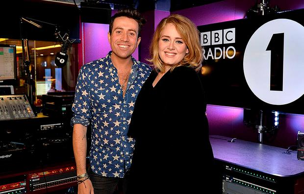 Handout photo taken from the Twitter feed of @R1Breakfast of award-winning singer Adele with BBC Radio 1 Breakfast presenter Nick Grimshaw, where the singer said it is a