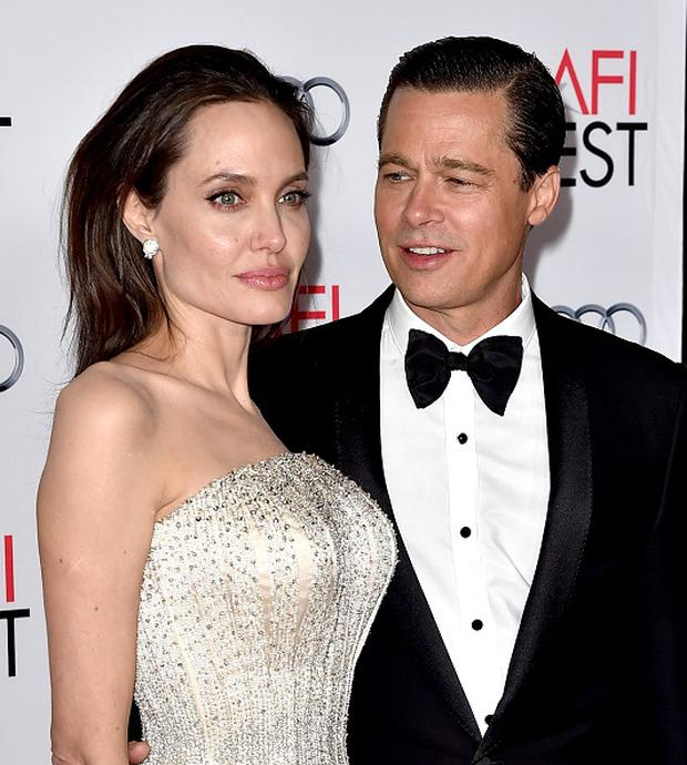 LOS ANGELES, CA - NOVEMBER 05: Actress/director Angelina Jolie Pitt (L) and husband actor Brad Pitt arrive at the AFI FEST 2015 presented by Audi opening night gala premiere of Universal Pictures'