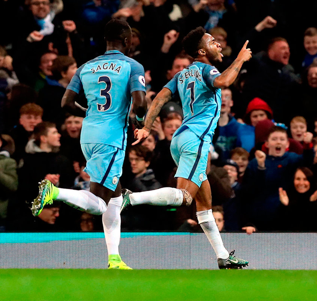 Manchester City's Raheem Sterling celebrates scoring his side's second goal against Arsenal at the Etihad Stadium yesterday. Photo: PA